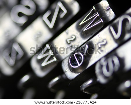 detail of the letter W of very old typewriter and other letters - stock photo