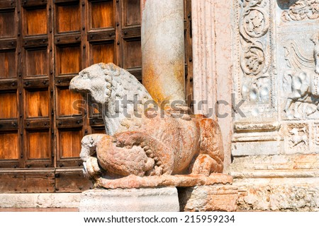 Detail of the lion and column in red marble of the Basilica of San Zeno (X-XI century) in Verona Italy. Is considered one of the masterpieces of Romanesque architecture in Italy - stock photo