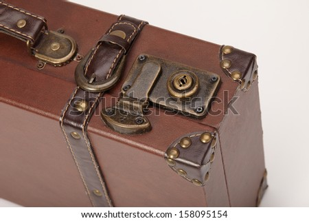 Detail of the lock on an old vintage suitcase - stock photo