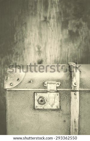 Detail of the lock on an old vintage trunk. Toned Effect under Retro style - stock photo