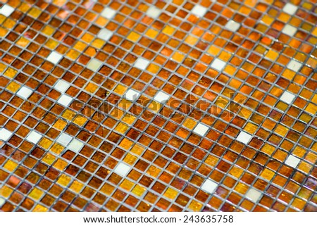 detail of the mosaic tile wall background - stock photo