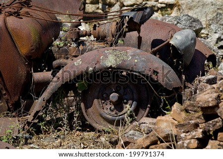 Detail of the mudguard of a rusty old car. Rusty abandoned old car - stock photo