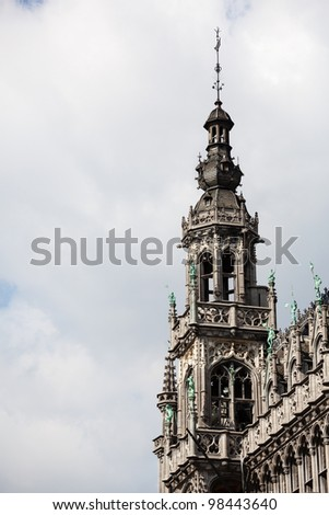Detail of the roof and statues on Kings House or Breadhouse in Grand Place in Brussels - stock photo
