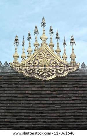 Detail of the roof of the Wat Xieng Thong, Luang Prabang, Laos. - stock photo