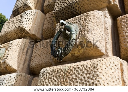 Detail of the rustication stone work and bronze rings of the Palace of Charles V in The Alhambra, Granada, Spain - stock photo