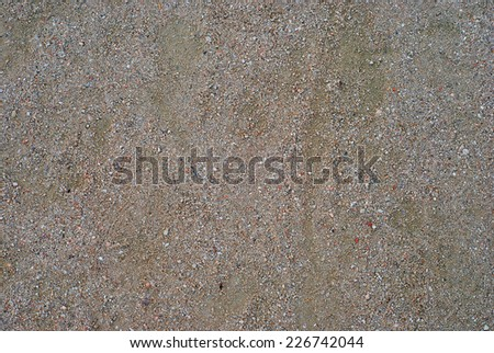Detail of the sand in the ground of a path - stock photo