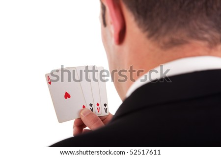 detail of the shore of a man with four cards with four aces in hand, isolated on white background, studio shot - stock photo