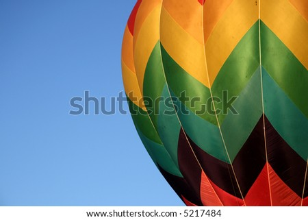 Detail of the side of a colorful hot air balloon - stock photo
