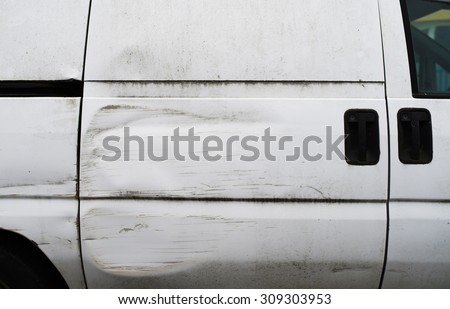 Detail of the side of a van which had an accident