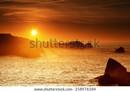 Detail of the solar disk at sunset on the Cantabrian coast - stock photo