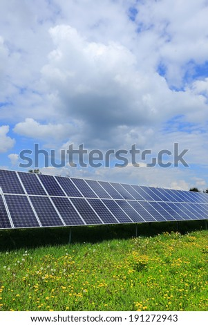 Detail of the Solar Power Station on the spring flowering Meadow