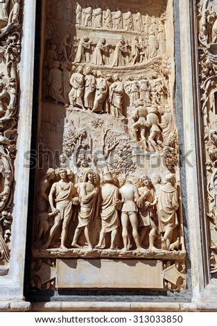 Detail of the statue of the artistic facade of famous Abbey called Certosa di Pavia in Italy