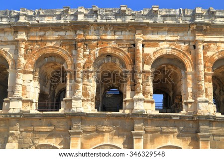 Detail of the stone arches of the Arena of Nimes, an old Roman amphitheatre in Nimes, Languedoc Roussillon, France