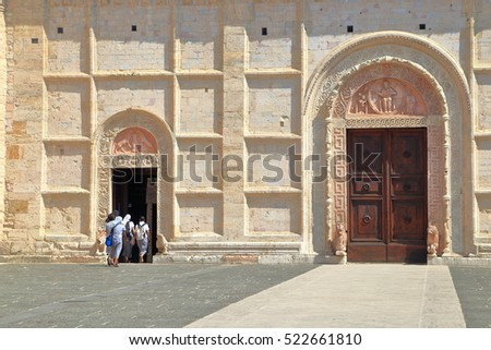 Detail of the stone facade and entrance to the Cathedral in Assisi, region of Umbria, Italy