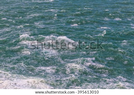 Detail of the storm, the water boils. Raging ocean. - stock photo