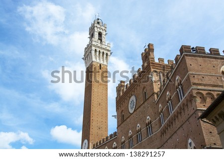 Detail of the Torre del Mangia and Piazza del Campo, Siena, Tuscany, Italy.
