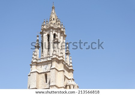 Detail of the tower of the church and collegiate of San Miguel, it was built in Gothic-Renaissance style and it is located in Ampudia (Palencia, Spain) - stock photo