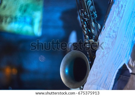 Detail of the trumpet of a brass saxophone. A musical instrument used by a rock band.