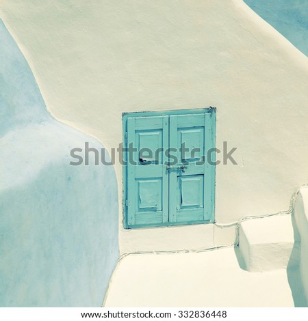 Detail of the typical blue and white house in Oia, Santorini island, Greece. Square toned image, instagram effect - stock photo