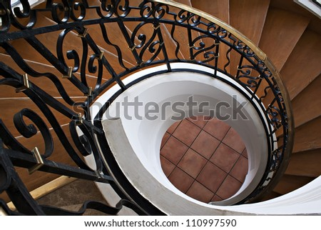 Detail of the wood spiral staircase in the hotel - stock photo