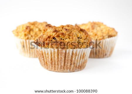 Detail of three gluten free muffins with nuts isolated on white background - stock photo
