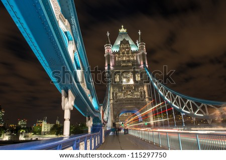 Detail of Tower Bridge in London at night with car light trail - London - UK - stock photo