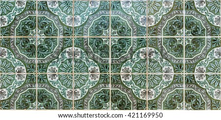 Detail of traditional azulejos tiles on facade of old house, Algarve, Portugal - stock photo