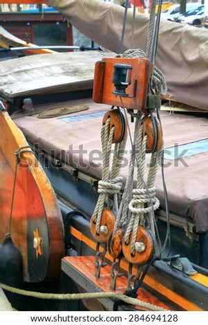 Detail of traditional wooden boat along one of the canals in the Jordaan neighborhood, Amsterdam, Holland