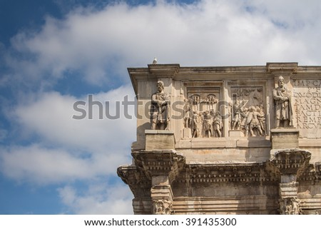 Detail of Triumphal Arch, Rome, Italy Details of the decorations of the Triumphal Arch beside Colosseum in Rome. Intense clouds on the blue sky. - stock photo