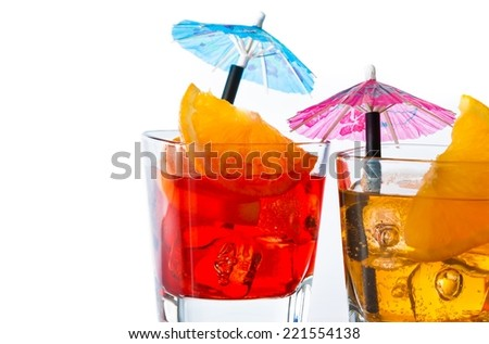 detail of two cocktail with orange slice and umbrella on top isolated on white background with space for text - stock photo