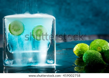 Detail of two small limes immersed in an effervescent liquid - stock photo