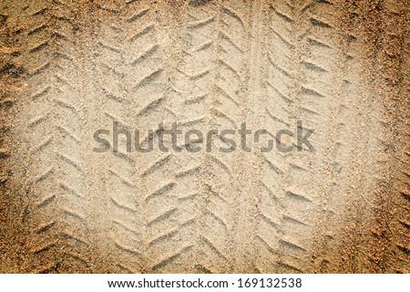 Detail of tyre tracks in sand desert - stock photo