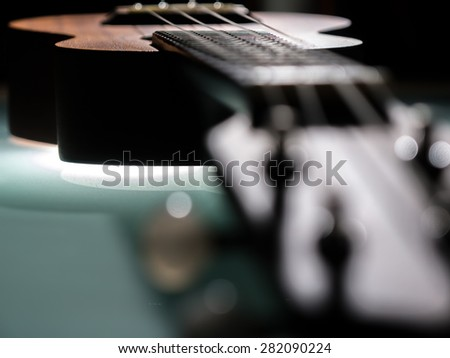 detail of ukulele with shallow depth of field