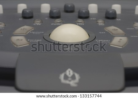 detail of ultrasound control buttons with trackball - stock photo