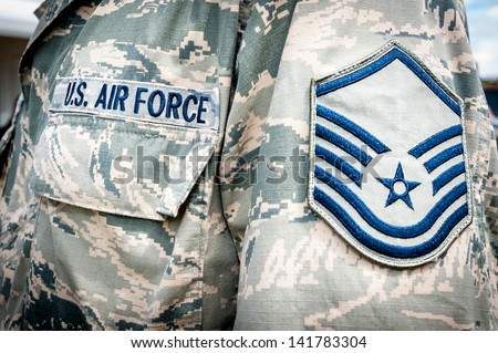Detail of United states air force soldier's uniform with emblem in focus. - stock photo