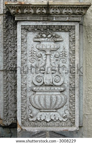 Detail of vintage column with floral patterns