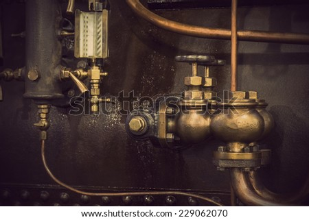 Detail of vintage machine with pipes and valves