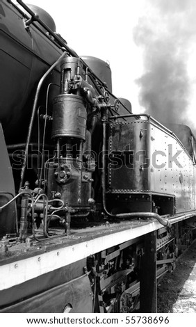 Detail of Vintage steam engine, working, with smoke - converted to black and white
