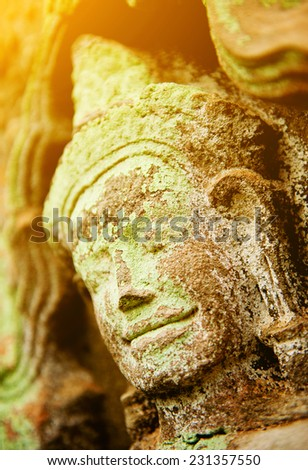 Detail of vintage stone face in the Bayon temple at Angkor Wat, Cambodia - stock photo
