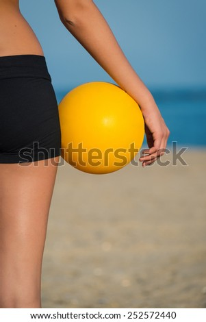 Detail of volleyball female player at the beach.