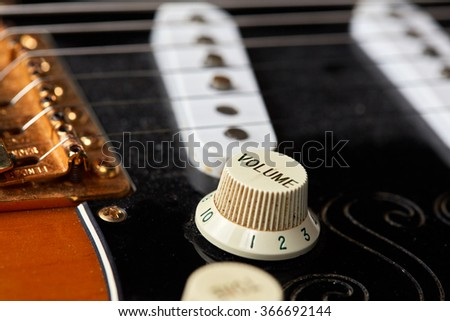 Detail of volume knob and string of a vintage electric guitar - stock photo