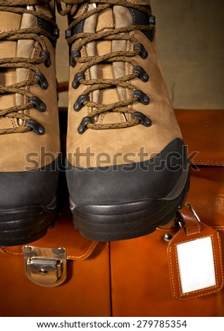 detail of walking boots with grip sole - stock photo