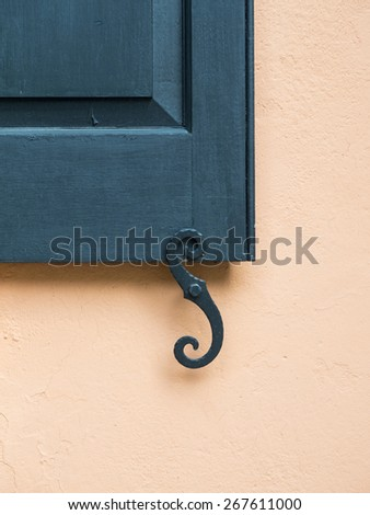 Detail of wall, shutter and shutter dog in Charleston, South Carolina. - stock photo