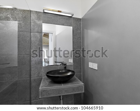 detail of washbasin in a modern bathroom with gray wall - stock photo