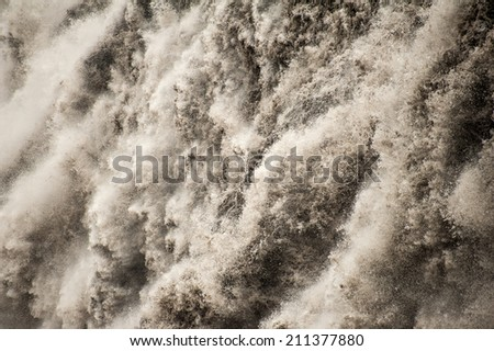 Detail of water from Detifoss waterfall. Dettifoss is the most powerful waterfall on Iceland and in the whole Europe. - stock photo