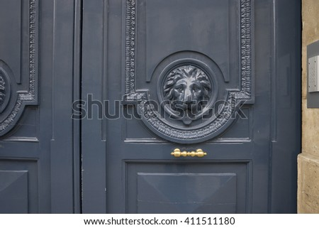 Detail of what work on vintage door in Paris, France - stock photo
