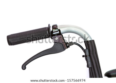 Detail of wheelchair handlebar with break on white background