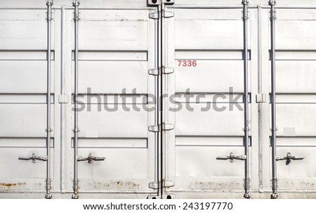 Detail of white door shipping container at container yard - stock photo