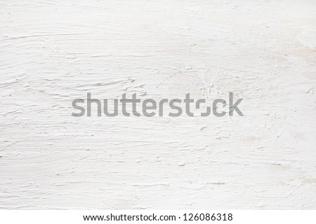 Detail of white painted and plastered wall.  Rough texture on wooden board. - stock photo