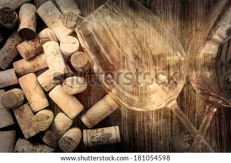Detail of wine glasses and corks in filtered old vintage style - stock photo